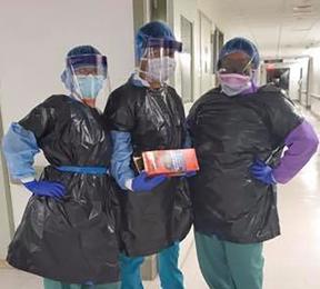Nurses in trash bags